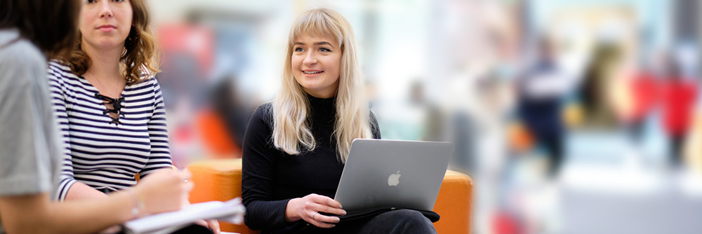 A woman sat with a laptop