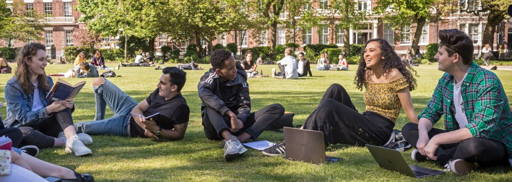 Students sitting on a lawn