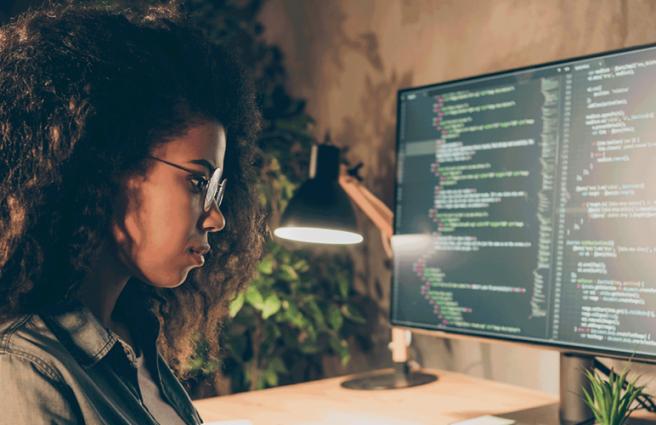 A woman looking at a computer screen
